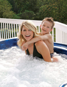 Mother and son in hot tub